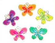 Enameled alloy two-tone butterfly charms / pendants